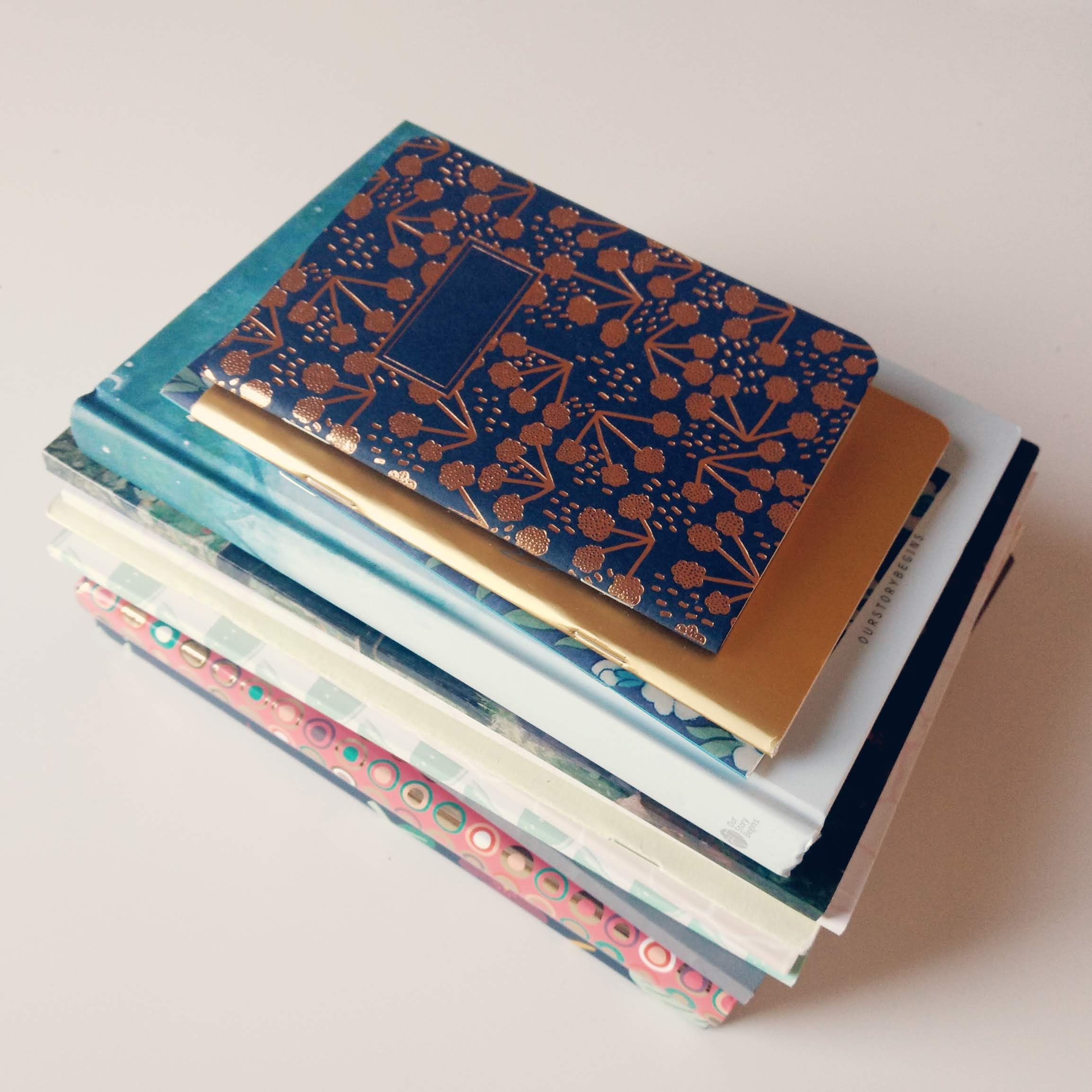 A stack of pretty notebooks.